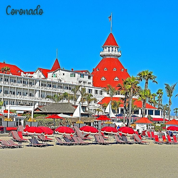 The red roofs and white facade of the Hotel del Coronado right by the beach. It's a perfect resort option for where to stay during a girls weekend in San Diego.