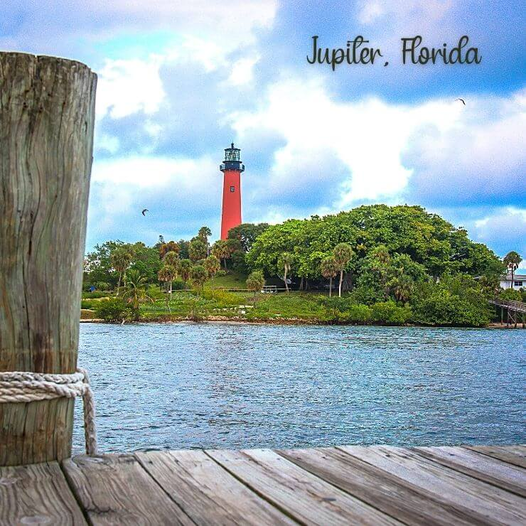 Jupiter Inlet Lighthouse seen from a dock on the water in Jupiter, Florida.